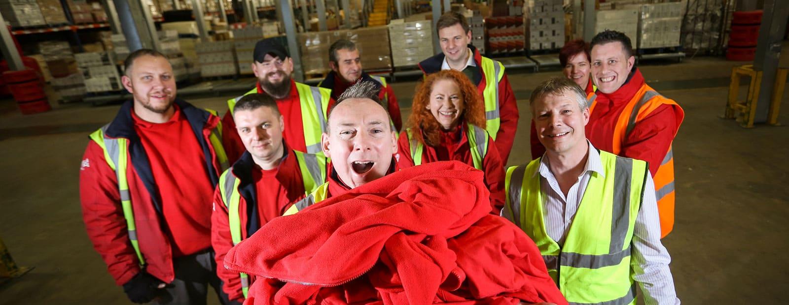 Europa Warehouse employee James delivering clothing to Kenya